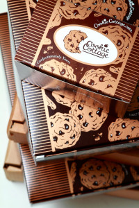 Cookie Cottage's current design is not only eye catching, but truly represents how gourmet their product is.